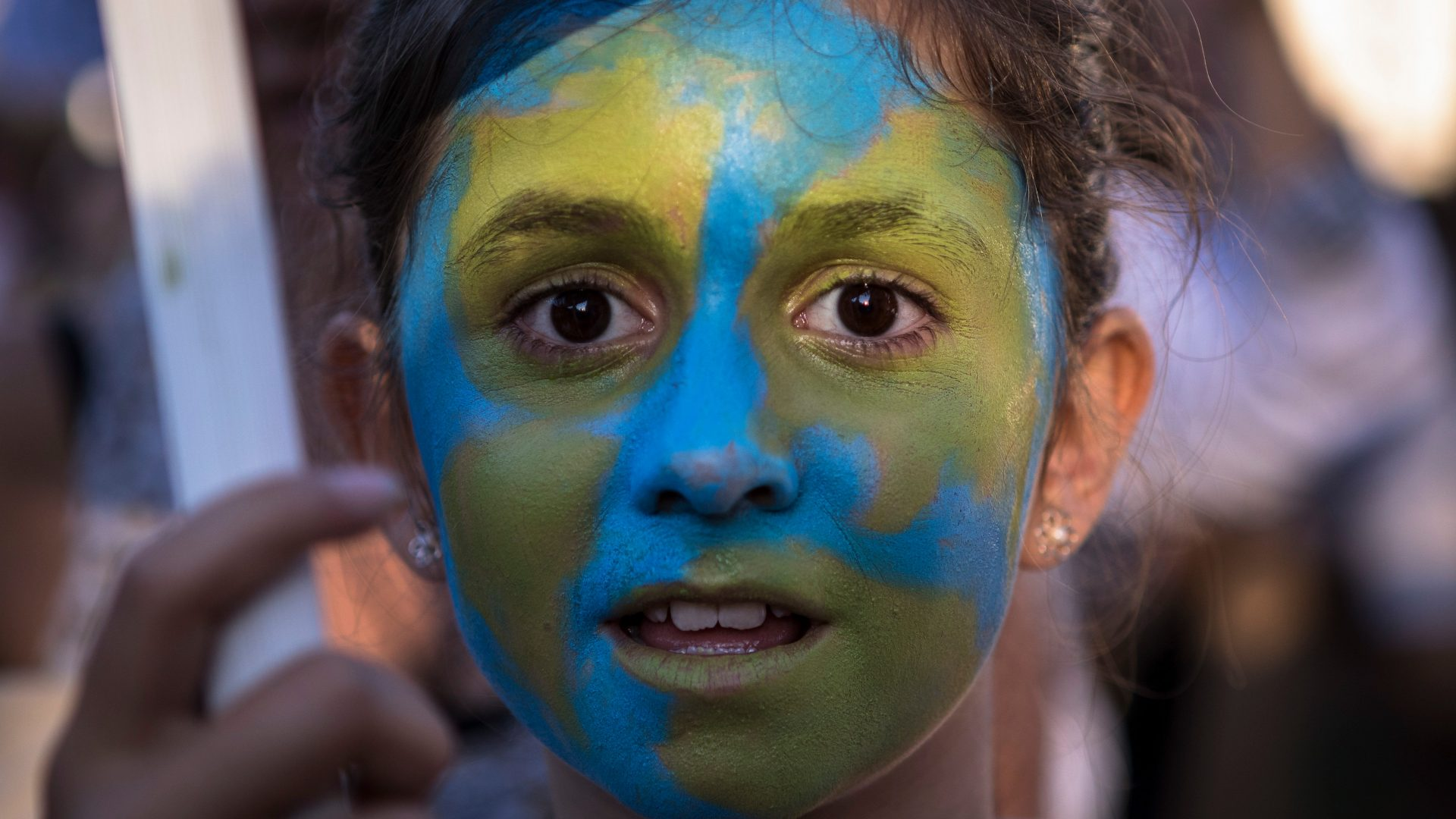 A young girl with face paintings during the Climate Strike in Madrid that was part of the global climate strikes all around the world.